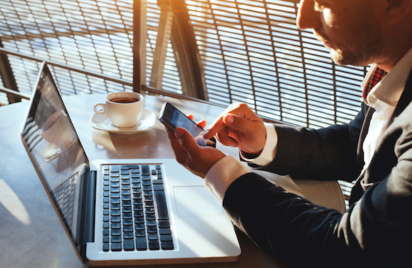 Business traveler using the internet to book a small property